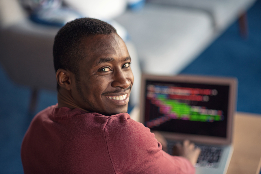 Online software course student smiling