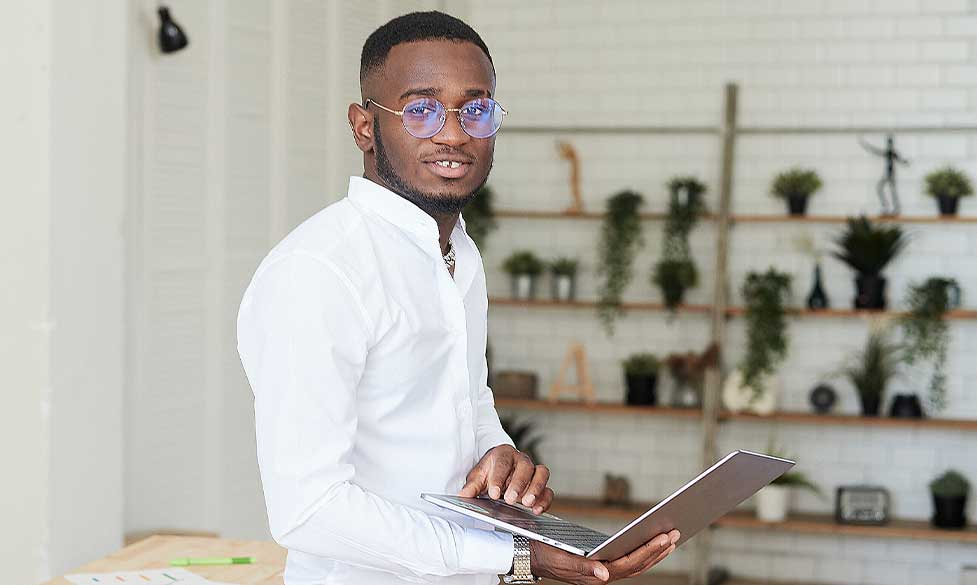 How to Become a Successful Executive Leader , male student working on laptop
